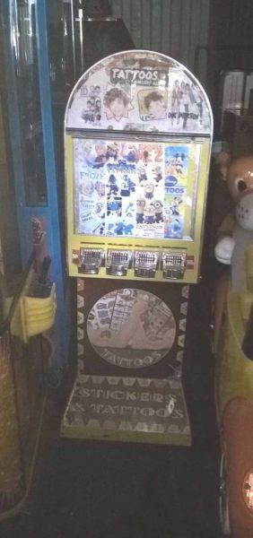 Tattoo sticker arcade machine